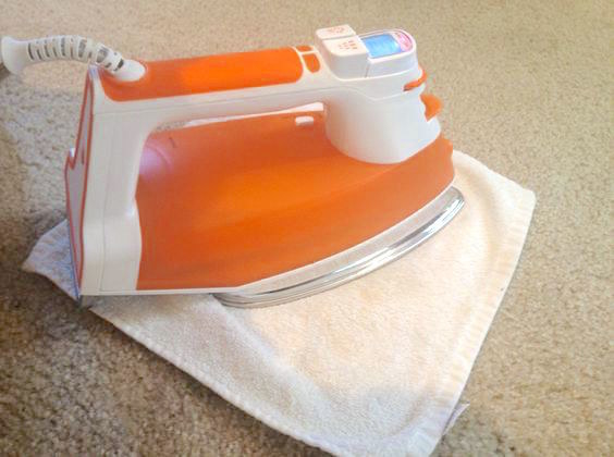 Banish carpet stains without excessive scrubbing by using your iron.