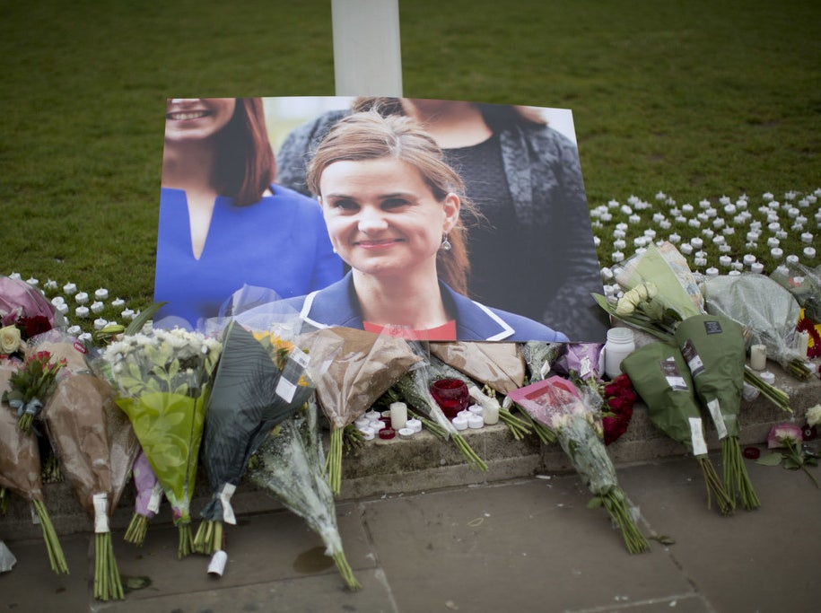 Tributes for Jo Cox outside the House of Parliament in London, Friday, June 17.