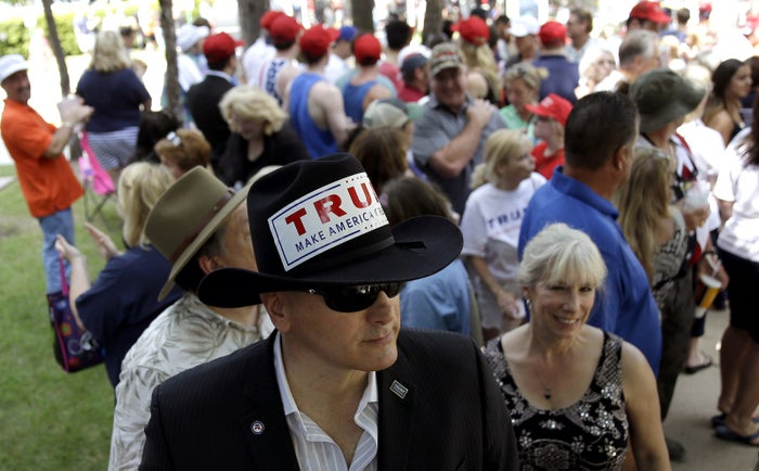 Trump supporter Niko Chrisoulis waits to enter a rally Friday in The Woodlands, Texas.