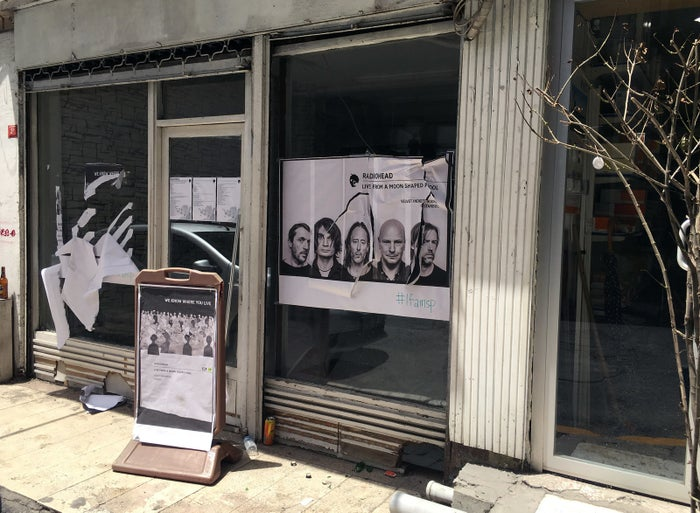 A ripped up Radiohead poster at the Istanbul record shop on Saturday.