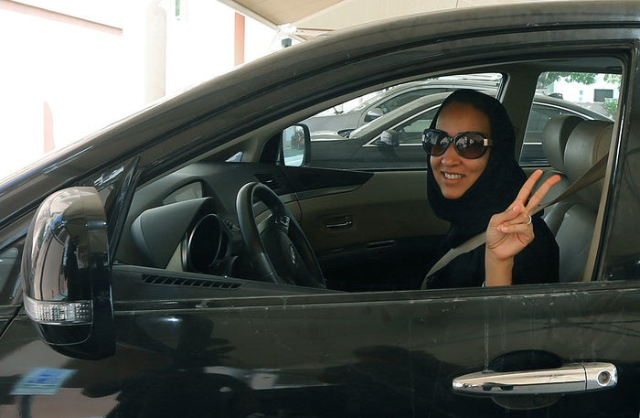 Saudi activist Manal Al Sharif, who now lives in Dubai, flashes the sign for victory as she drives her car