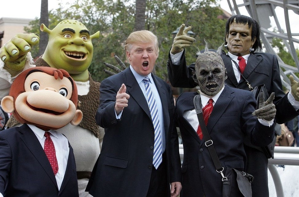 Donald Trump poses with Universal Studio characters at a casting call for his reality show The Apprentice in 2006.