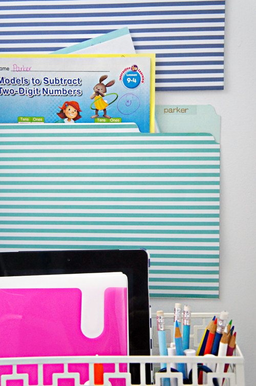 Turn file folders into wall pockets to keep your papers in order.