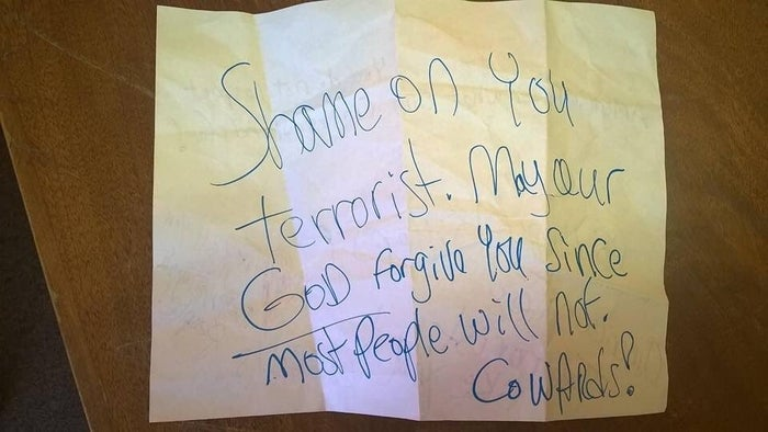 Otherside of the note allegedly posted on the family's apartment door.