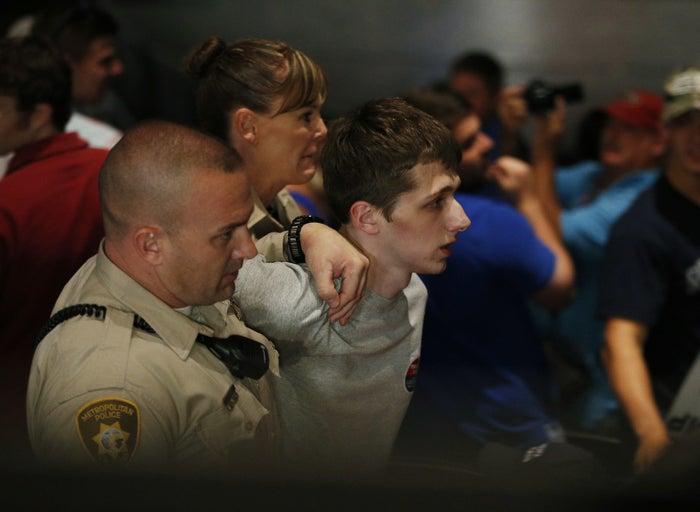 Police remove a man as Republican presidential candidate Donald Trump speaks at the Treasure Island hotel and casino.