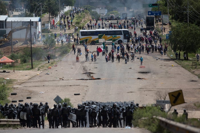 The two CNTE union leaders were arrested on corruption charges but members say their arrests were politically motivated. Since the arrests, members of the teaching union, which has a history of radical activism, have been blocking roads in southern Mexico.