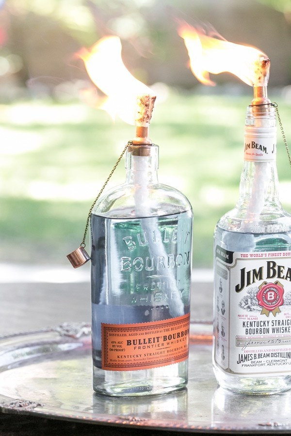 Convert empty liquor bottles into homemade tiki torches to light up your outdoor evenings.
