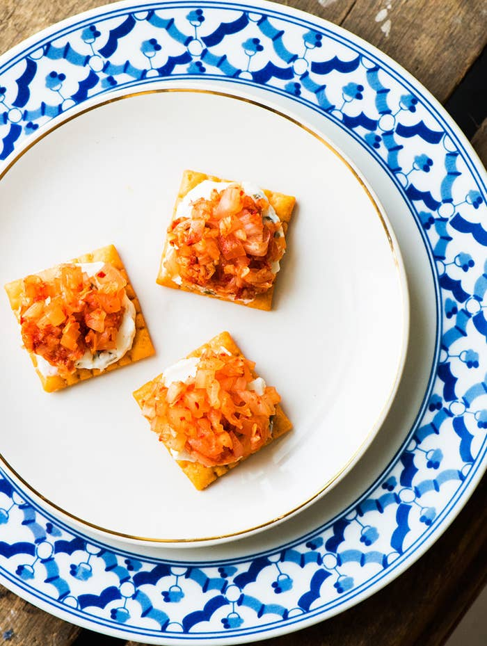 Unexpected? Yes. Unheard of? Not anymore. Kimchi and cheese forever please!* 3 large cheddar cheese snack crackers (1 inch)* 1½ tsp. Philadelphia® Chive & Onion Cream Cheese Spread* 1 Tbsp. chopped kimchi