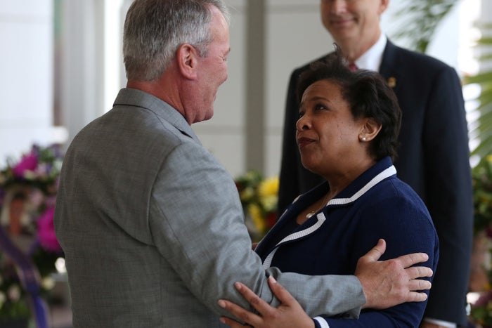 Attorney General for the United States Loretta Lynch and Mayor of Orlando Buddy Dyer hug in the main lobby of City Hall following the Pulse night club shootings last week in Orlando.