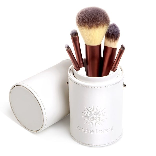A set of makeup brushes that comes with a cute little holder/carrying case.