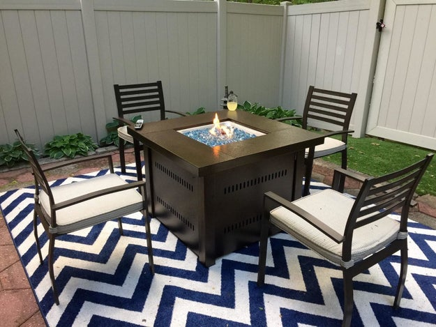 A fire pit that also doubles as an outdoor table for backyard entertaining.