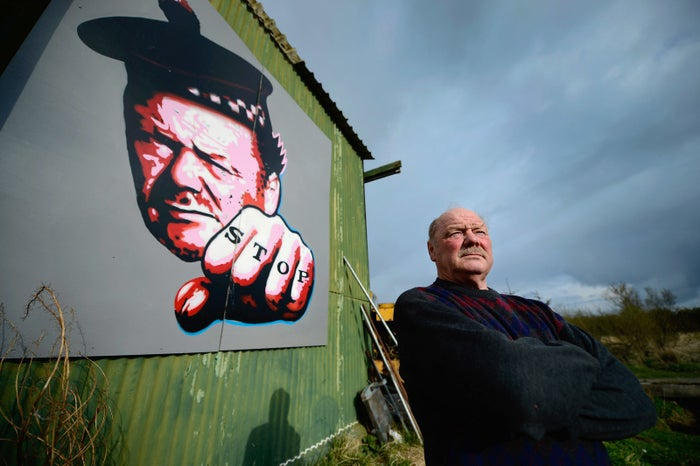 Michael Forbes, who hoisted the flag, pictured in 2012 standing beside a shed near to Donald Trump's golf course.
