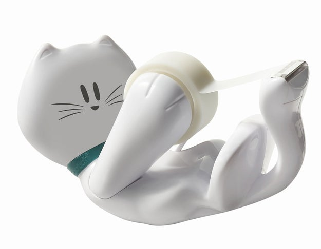 A playful kitty cat tape dispenser that will keep you company at your dest.