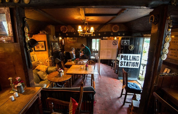 """The White Horse Inn in Priors Dean, Hampshire — also known as the """"Pub with no name"""" — serves as a polling station."""