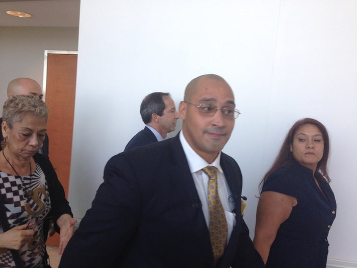 Richard Rosario leaves a Bronx courtroom with his wife, Minerva.
