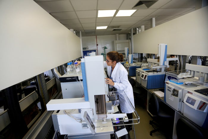 A woman works at the Brazilian Laboratory of Doping Control.