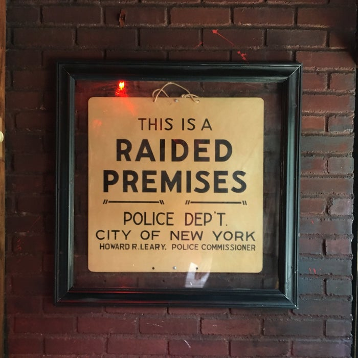 A sign hanging inside the Stonewall Inn.