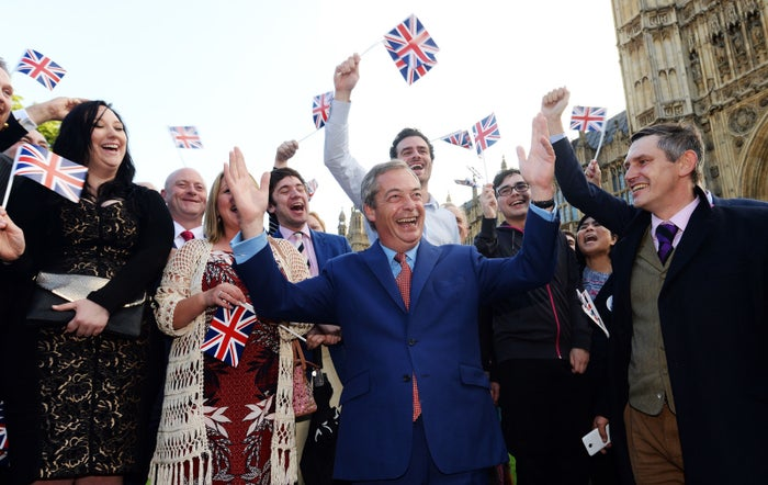 Nigel Farage and supporters on College Green, Westminster, after the final vote was confirmed.