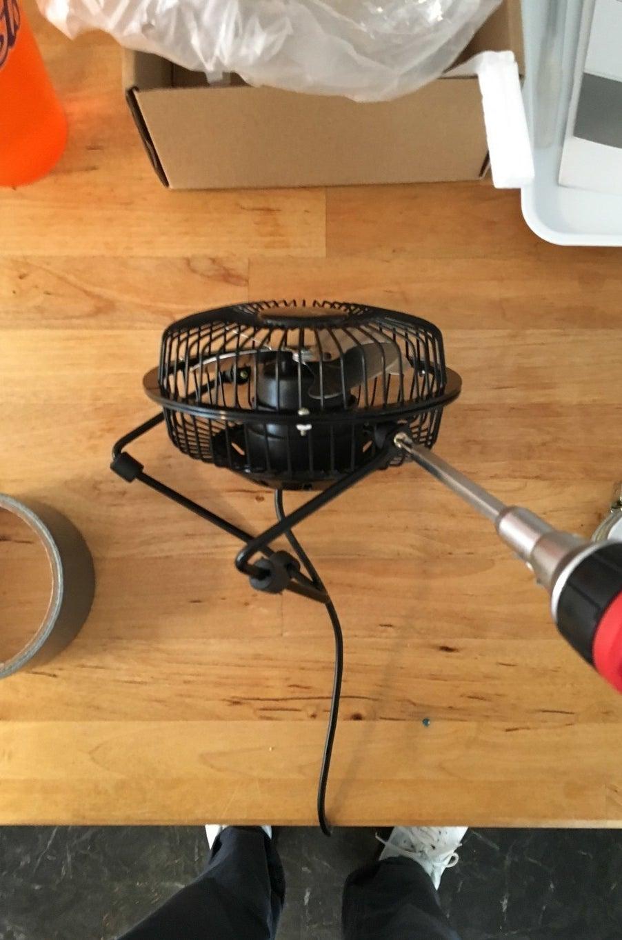 Unscrew the fan...