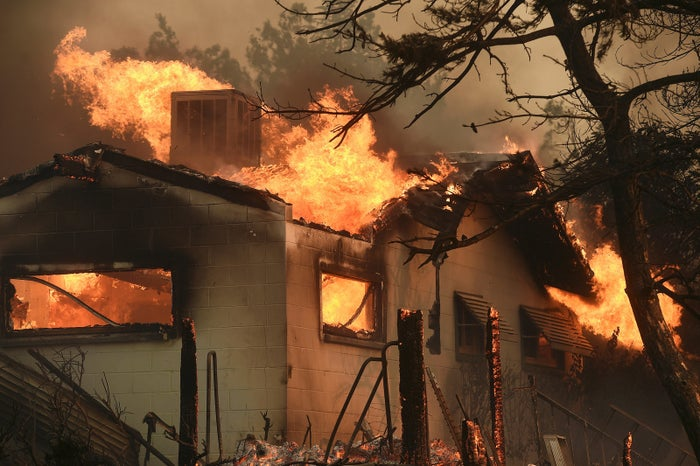 Flames from the Erskine Fire engulf a home near Weldon, California.