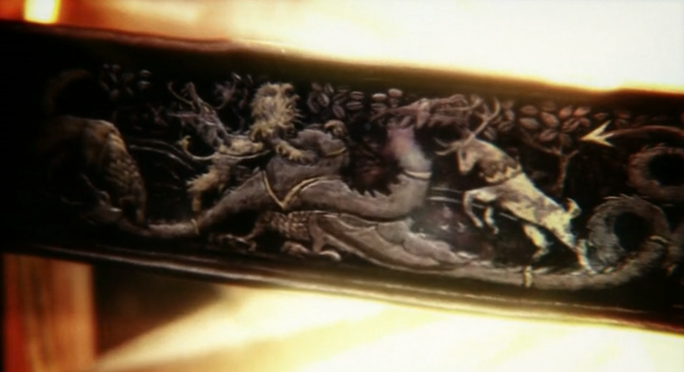 Throughout the opening titles we see close ups of it that depict the recent history of Westeros. Here you can see the Lannisters (the lion) and Baratheons (the stag) defeating the Targaryens (the dragon).