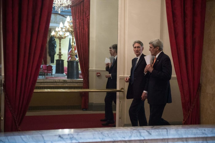 British Foreign Secretary Philip Hammond with U.S. Secretary of State John Kerry during a conference on Syria.