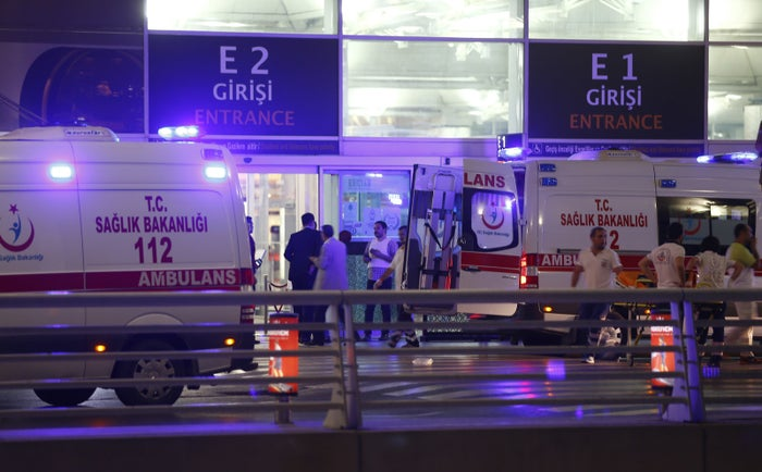 Ambulances arrive at Istanbul Ataturk Airport Tuesday.