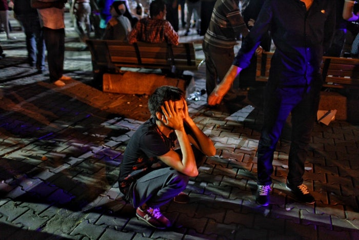 A relative of a victim waits dejectedly outside a hospital in Istanbul.