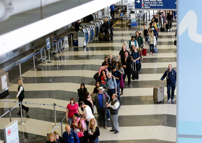 Travelers waiting for the TSA security check point at O'Hare International airport in Chicago.
