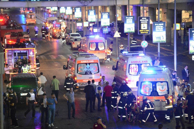 People leave Ataturk airport following a terror attack late Tuesday.