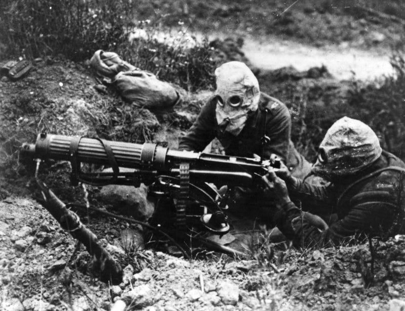 Gas-masked men of the British Machine Gun Corps with a Vickers machine gun during the first Battle of the Somme.