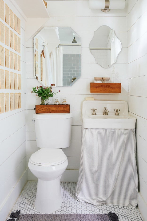 See every spot as a stylish storage opportunity — even the top of your toilet tank.