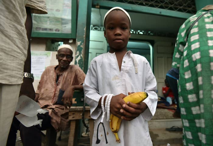 A boy holds a banana before breaking his fast in front of a mosque in Treichville, a district of Abidjan.