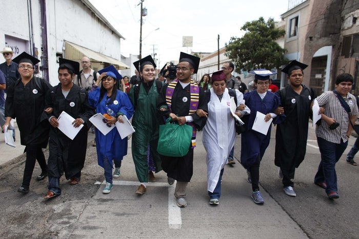 Lizbeth Mateo, in the blue gown, and eight other undocumented immigrants moments before presenting themselves to U.S. Customs and Border Protection.