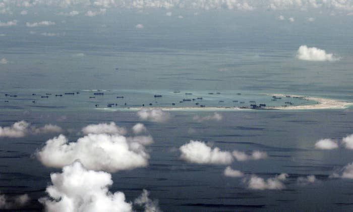 Land reclamation of Mischief Reef in the Spratly Islands in the South China Sea by Chinese vessels in 2015.