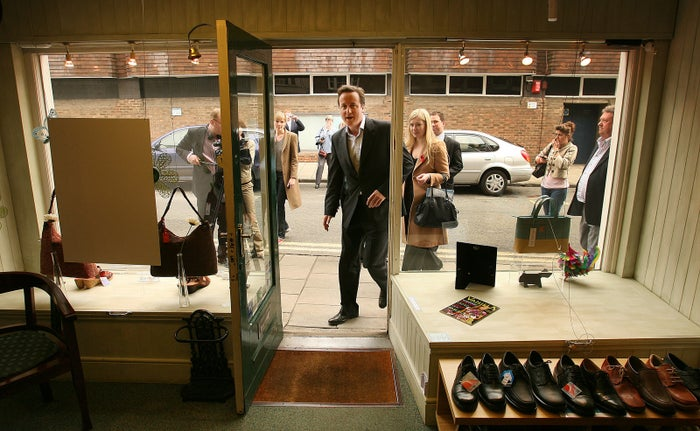 Here he is campaigning in the May 2007 local elections when he was merely leader of the Conservative party...by visiting a shoe shop! Little did he know back then what fabulous shoe fashion awaited him as prime minister in the years to come.