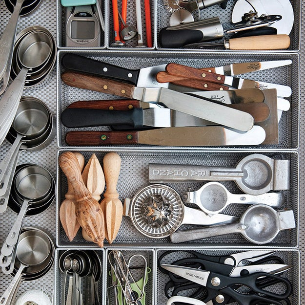 Divide up your drawers with mesh organizers from the office supply store to make sure every utensil has a spot.