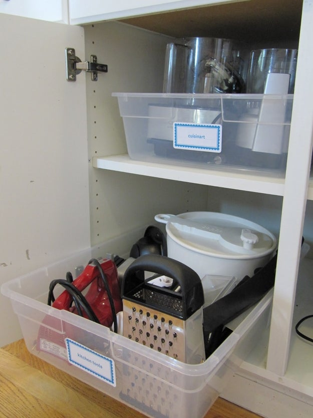 Stash under-bed storage bins in your deepest cabinets to make everything accessible, even in the back of the cabinets.