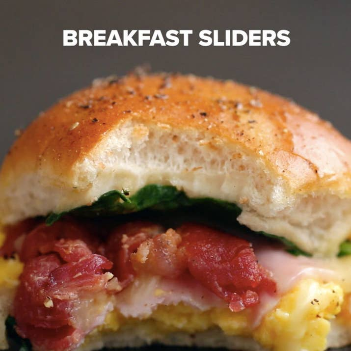 Servings: 12INGREDIENTS12-pack of dinner rolls or Hawaiian sweet rolls9 eggs, scrambled6 slices ham6 slices white cheddar8 strips cooked bacon3 ounces baby spinach2 tablespoons melted butter1 teaspoon black pepperPREPARATION1. Preheat oven to 350°F/175°C.2. Slice the rolls in half lengthwise.3. Place the bottom half on a 9x13 baking tray.4. Spread the eggs evenly on the rolls, followed by the ham, cheddar, bacon, and spinach.5. Place the remaining half of the rolls on top. 6. Brush with melted butter and sprinkle the pepper on top.7. Bake for 20 minutes.8. Slice, then serve!