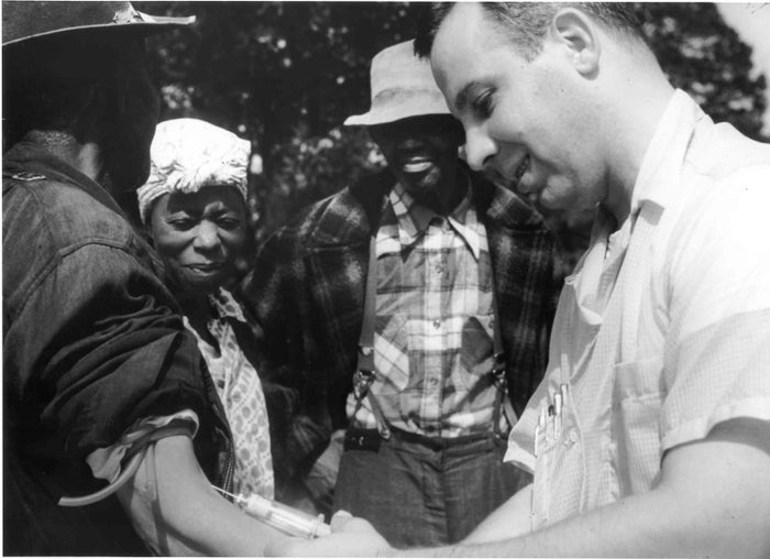 Doctor taking blood from a patient as part of the Tuskegee Syphilis Study.