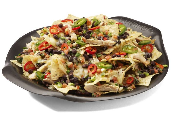 Cooking nachos on a grill? The insanity! It cooks all sorts of foods and it's microwaveable. Mmmm, 13 inches of immaculately conceived nachos. Get it from Amazon for $18.