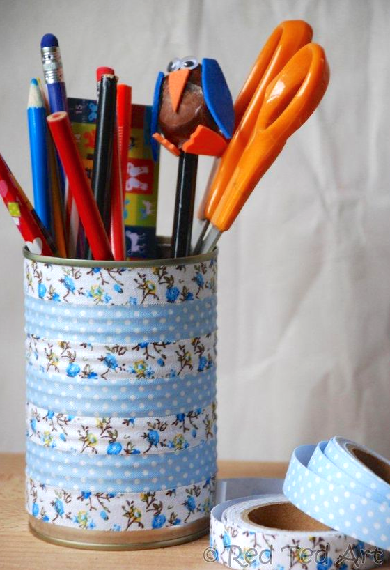 Cover empty aluminum cans with washi or fabric tape to make pretty pencil organizers on the cheap.