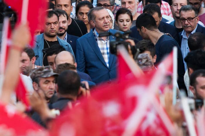 Turkish President Erdogan, center, spoke to a rally in Istanbul on Saturday.
