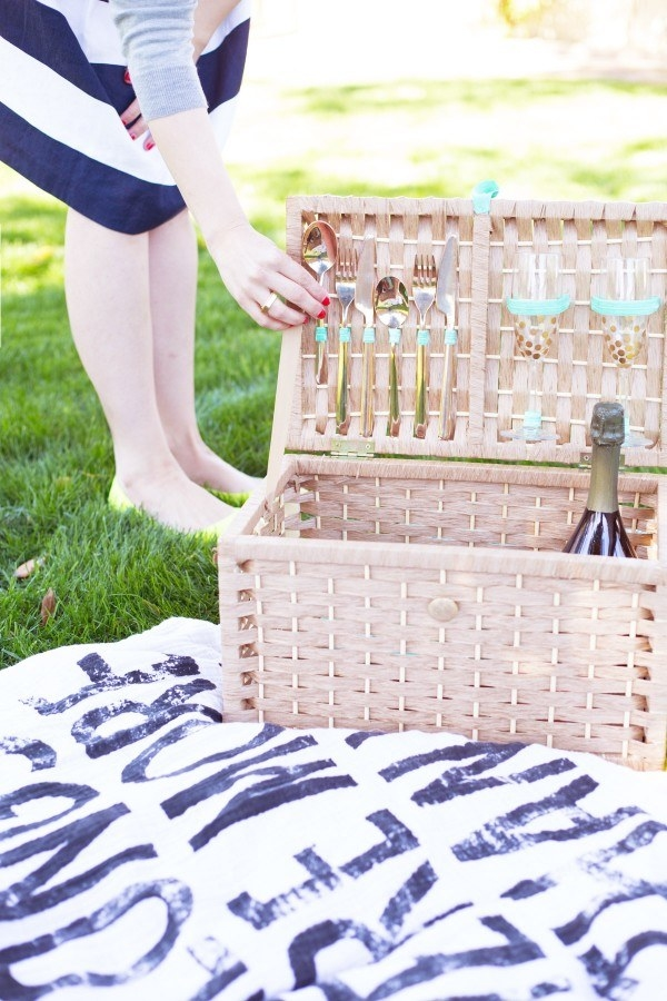 Transform any lidded basket into a custom picnic basket with glue and pretty elastic.