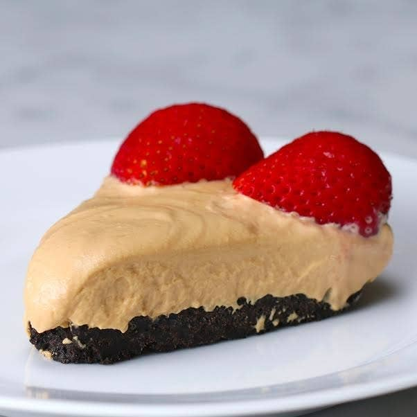 No-Bake Dulce De Leche CheesecakeRecipe by BuzzFeed TastyServes 8–10INGREDIENTSFor the crust:24 chocolate cream cookies⅓ cup melted butterFor the filling:13 ounces dulce de leche8 ounces cream cheese1 tablespoon vanilla extract1 cup whipped creamGarnish:8–10 strawberries, halvedINSTRUCTIONS1. Crush cookies and mix with butter. Spread mixture over pie pan, pressing down to make a compact crust. Refrigerate crust while making filling.2. Mix filling ingredients until smooth. Spread mixture over pie crust.3. Refrigerate the pie for at least 4 hours or overnight. (If you're in a hurry, you could also freeze the pie for 1–2 hours.)4. Top with strawberries, cut, and serve.5. Enjoy!