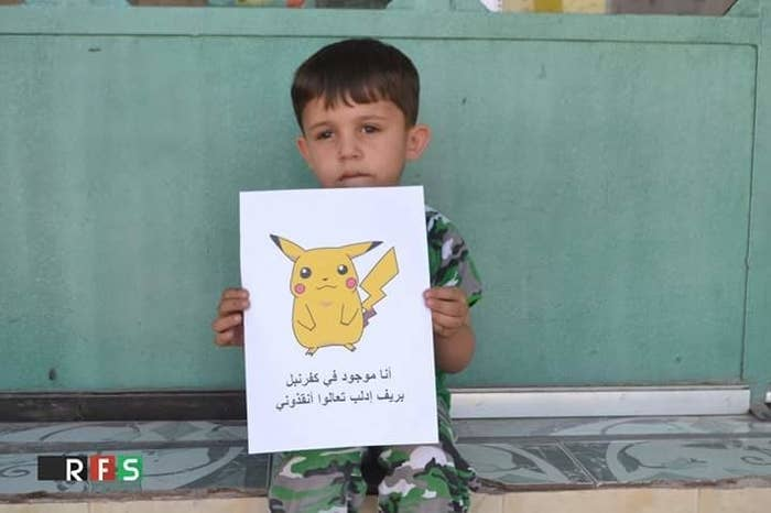 """""""I'm from Kafranbel in Idleb, come to save me!"""" reads the text under the Pikachu in this picture."""