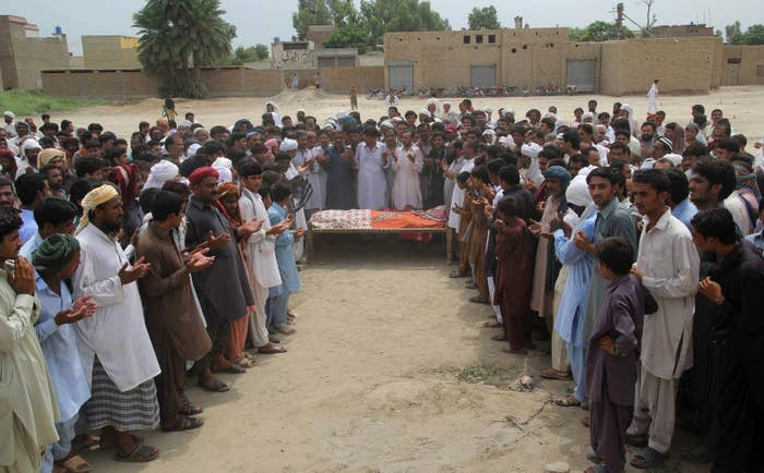 Relatives and residents offer funeral prayers for Qandeel Baloch.