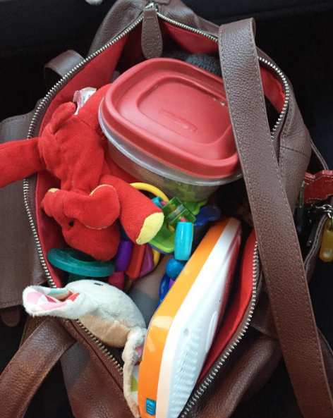 Speaking of purses, yours is definitely oversized and filled with toys, snacks and pacifiers.