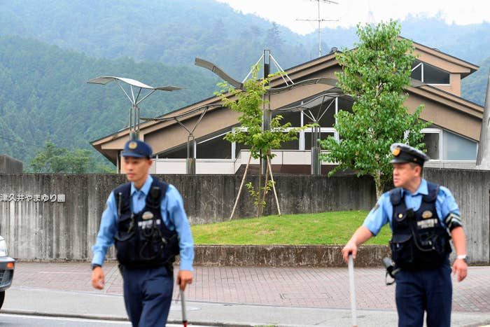 Police officers stand guard at the scene of the attack in Sagamihara, Japan.