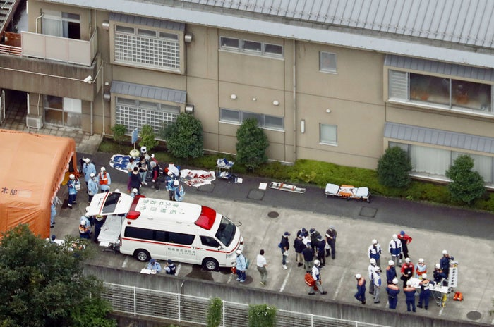 First responders aid the injured at the Tsukui Yamayuri-en.